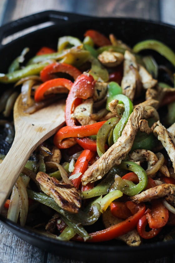 This Tequila Chicken Fajitas recipe is made delicious with an overnight Margarita marinade of tequila, triple sec and lime juice and traditional fajita seasonings and veggies!