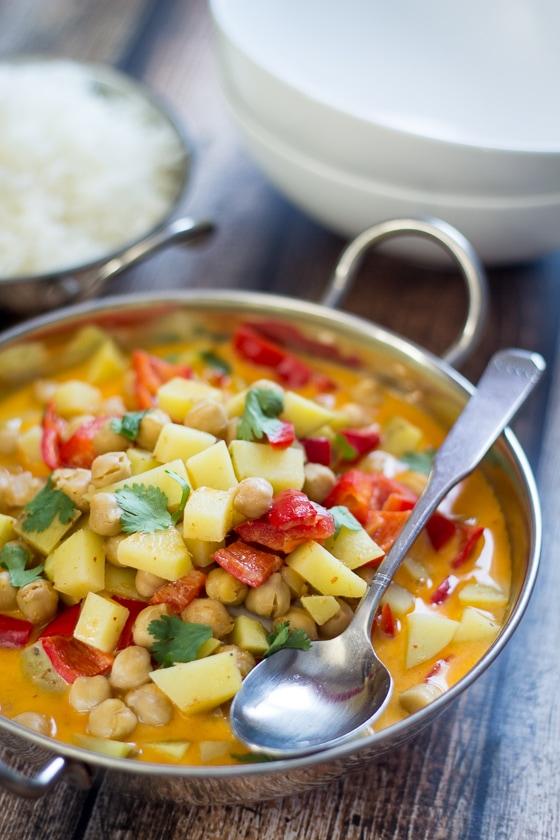 This Easy Vegetarian Chickpea Curry recipe is so delicious, mixing red curry paste, coconut milk, red bell pepper, Yukon gold potatoes and chickpeas.