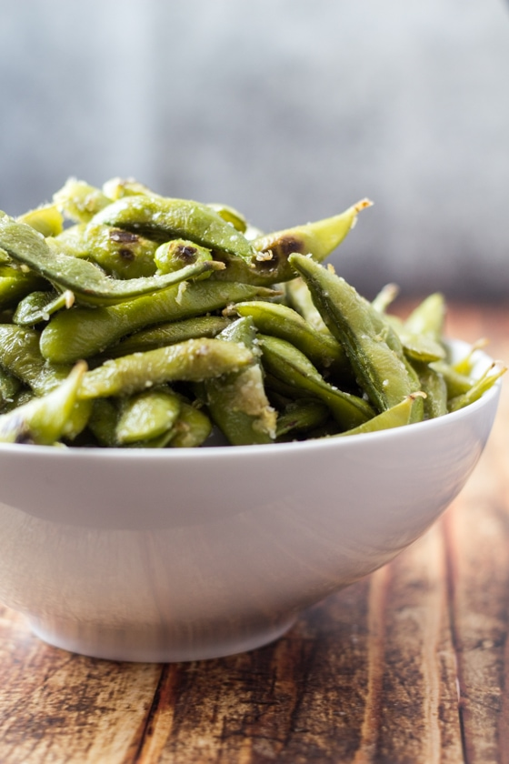 Looking for edamame beans recipes? Try this one today! This Ginger and Garlic Edamame Beans recipe is so easy with edamame beans, olive oil, grated ginger and garlic and sea salt for a delicious appetizer or side dish.