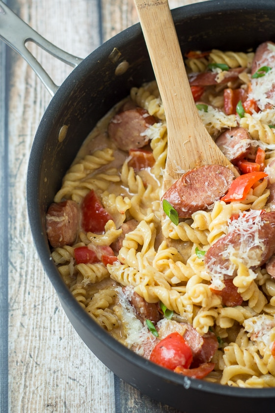 This Kielbasa Peppers and Onions Pasta recipe comes together quick and easy in one pot with a delicious mix of Kielbasa, red bell pepper, yellow onion, tomatoes, Parmesan cheese and rotini pasta.