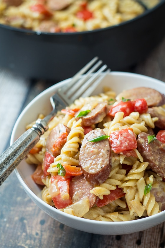 This Sausage and Pepper Pasta recipe comes together quick and easy in one pot with a delicious mix of Kielbasa, red bell pepper, yellow onion, tomatoes, Parmesan cheese and rotini pasta.