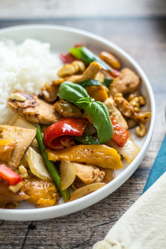 This Mango Chicken Thai Stir Fry recipe is a delicious mix of chicken, mango, cashews, bell pepper, scallions, onion, garlic and Thai chili paste that will have you wanting more.