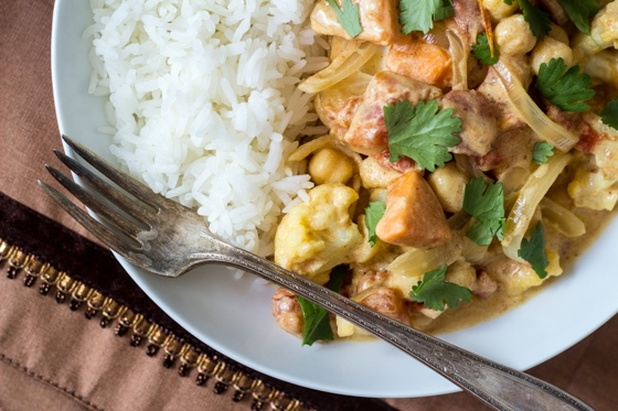 This Quick Fall Vegetable Curry recipe is a delicious mix of sweet potatoes, cauliflower, yellow onion, tomatoes, and chickpeas in a tasty curry sauce.