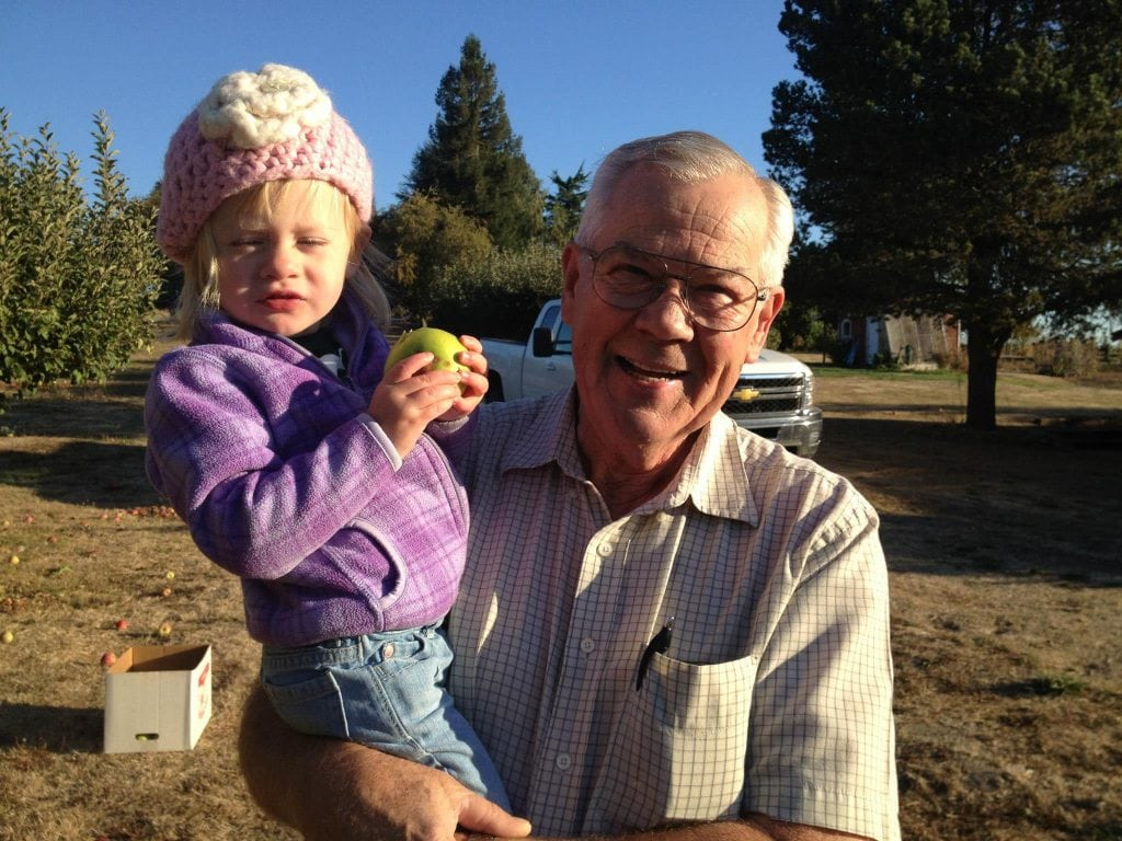 My dad and my niece, Lily, picking cider apples at the orchard.