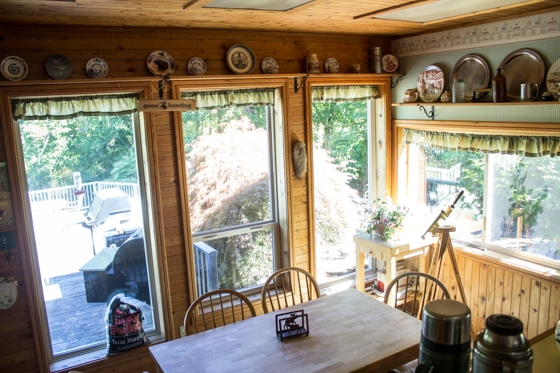 Here's a view from the kitchen into the eat-in kitchen. The view from the eat-in kitchen overlooks the deck and the pond.