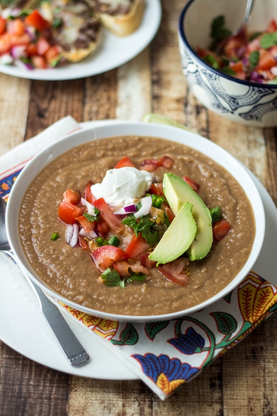 Easy Mexican Pinto Bean Soup Recipe - tastes like 7-layer dip, without the guilt! This Mexican Pinto Beans Soup Recipe is delicious!