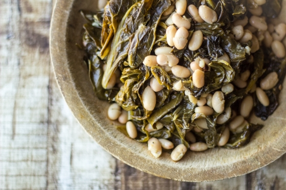 """An """"All-American"""" take on classic collard greens and beans recipe using fresh collard greens and tender Great Northern beans."""