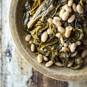"""An """"All-American"""" take on classic beans and greens using fresh collard greens and tender Great Northern beans."""