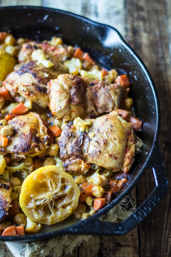 Chickpeas, carrots, and cauliflower add bulk to turn this pan roasted harissa chicken into a one-skillet meal!