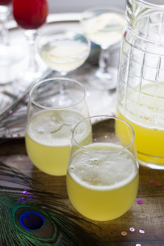 It is easy to host a Mardi Gras Cocktail Party and make these amazing cocktails: a lavender twist on the classic French 75 Cocktail, a Blackberry-Cointreau Bellini, and a Pineapple-Ginger Rum and Champagne Punch.