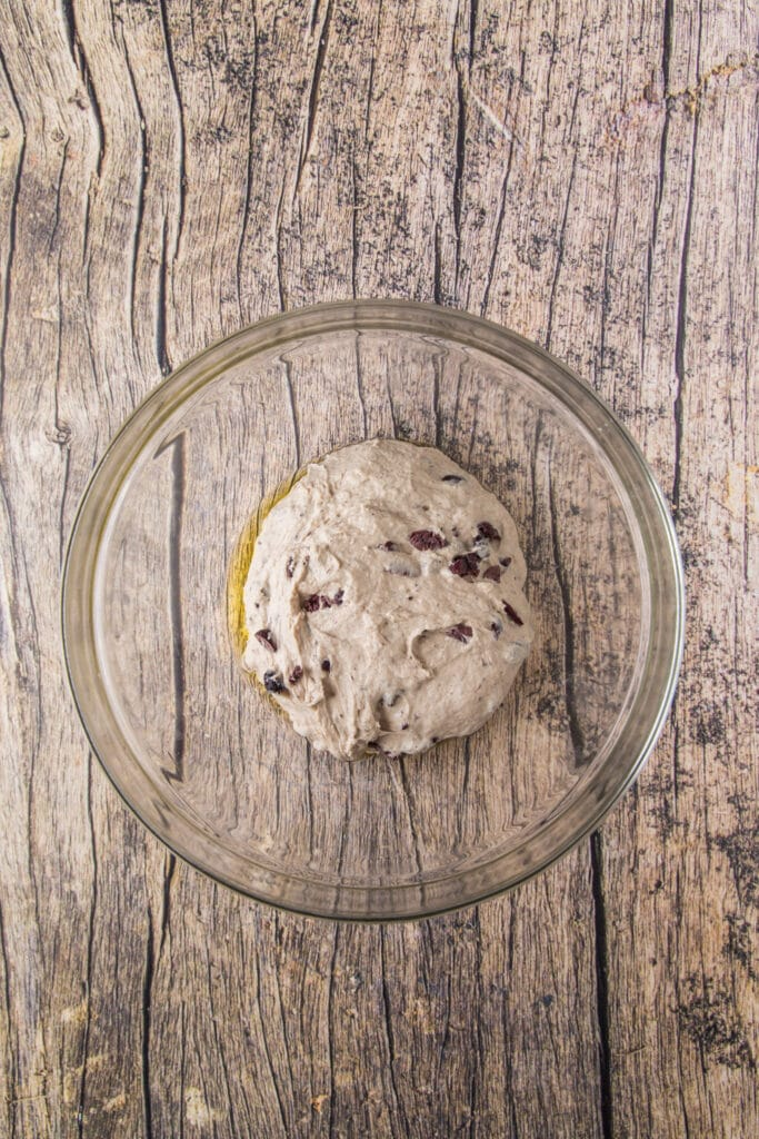 This Easy Rustic Olive Bread recipe uses salty kalamata olives to add a depth of flavor to this rustic bread recipe!