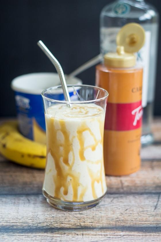 Vanilla frozen Greek yogurt stands in for ice cream in this lightened up version of my favorite Bananas Foster Milkshake!