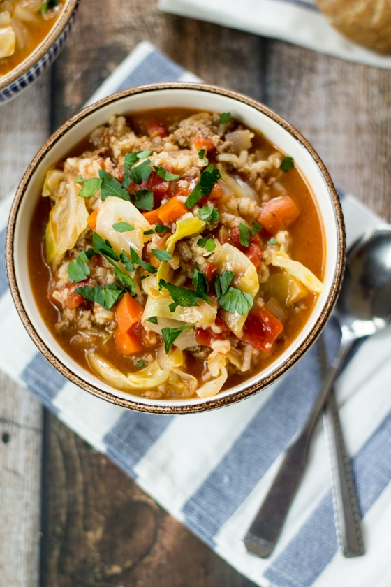 Looking for cabbage roll soup recipes? Here is an easy, delicious one! All of the flavor of homemade cabbage rolls without the hard work of rolling them. This cabbage roll soup hits the spot every time!