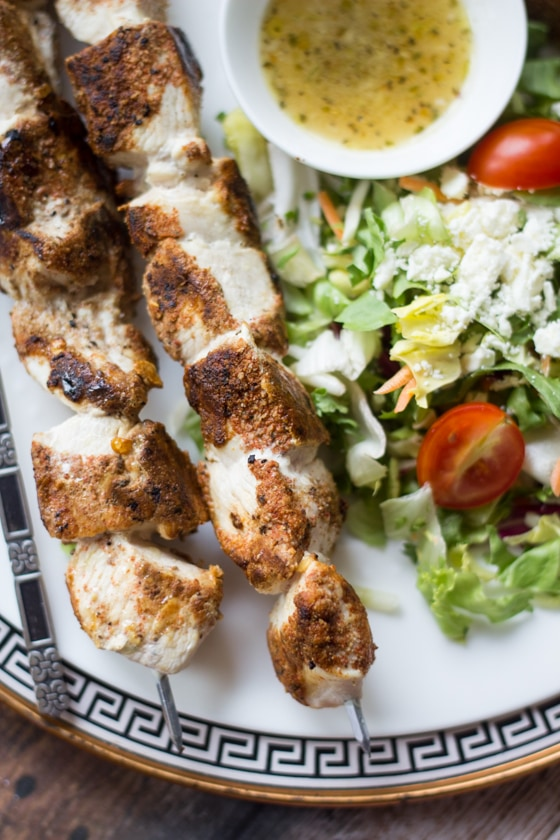 These Greek Chicken Skewers are rolled in a blend of inspired spices before being cooked to golden perfection and served with a lemony dipping sauce. A green salad and a glass of red wine make it a meal!