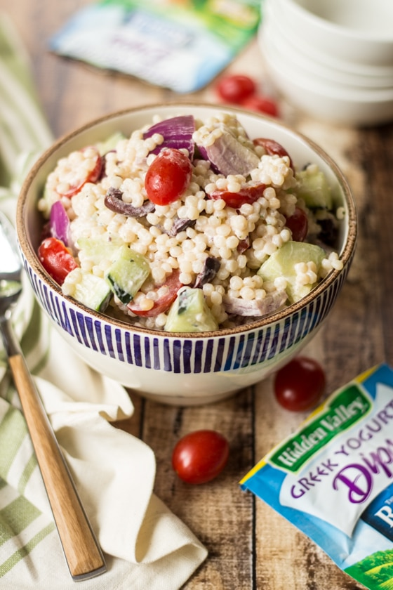 This Greek Couscous Pasta Salad recipe uses Hidden Valley's new Greek Yogurt Dip Mix to add bold ranch flavor to a perfect summer salad!