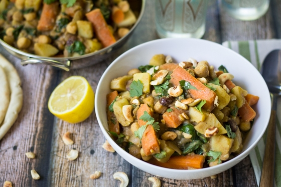 Looking for easy Indian Vegetarian Recipes?  Here is a delicious one! Spiced potatoes, chickpeas and carrots are simmered in a savory vegetable broth with spinach and plump raisins. Toasted cashews and fresh lemon juice add crunch and freshness to this hearty meal!