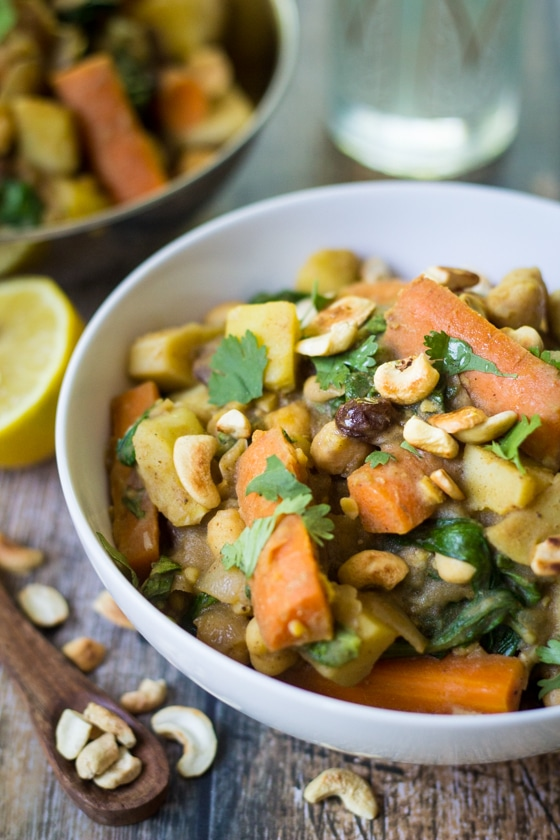 Looking for vegan Indian recipes?  Here is a great one! Spiced potatoes, chickpeas and carrots are simmered in a savory vegetable broth with spinach and plump raisins. Toasted cashews and fresh lemon juice add crunch and freshness to this hearty Indian Chickpea Stew!