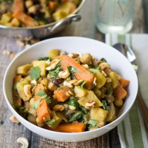 Spiced potatoes, chickpeas and carrots are simmered in a savory vegetable broth with spinach and plump raisins. Toasted cashews and fresh lemon juice add crunch and freshness to this hearty meal!
