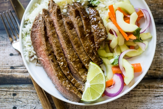 A simple glaze of Hoisin sauce, fresh ginger, and lime juice transform this humble flank steak into a dinnertime favorite!