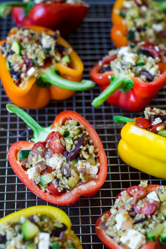 Get your fill of ancient grains with these Mediterranean Stuffed Bell Peppers, piled high with Freekeh, zucchini, tomatoes, olives, Feta cheese, and toasted pine nuts.