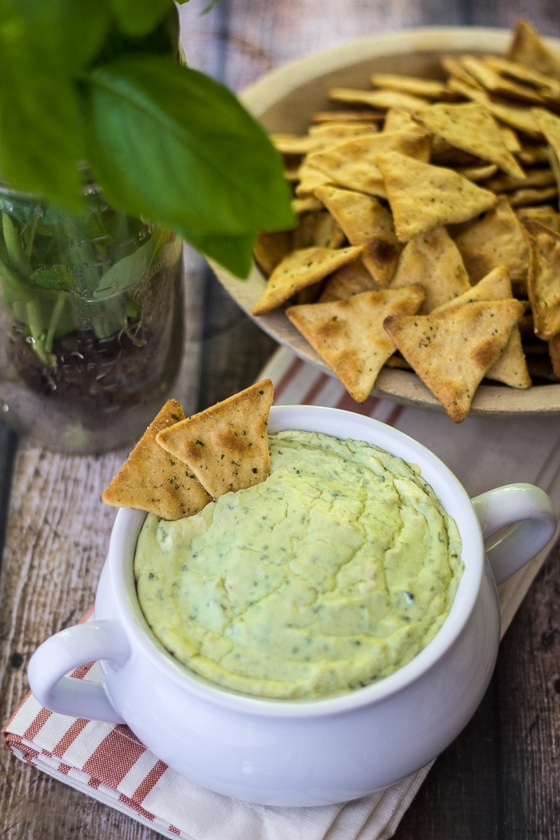 Fresh basil, nutty Parmesan, and thick cream cheese bubble up into a warm, fluffy bite of heaven in this Hot Basil Parmesan Dip!