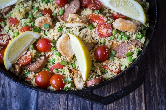 Looking for couscous recipes? Here is a great one! This Couscous Paella recipe blends chicken, sausage and couscous with peas, cherry tomatoes, red bell pepper, garlic, olive oil and spices for a delicious, easy and filling one pan dish!
