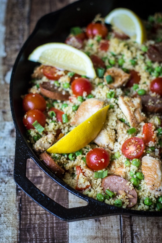 "Couscous ""Paella"": Loaded with sausage, chicken, and lots of vegetables, this one-pan dish is as filling as it is easy! This fun twist on classic Paella uses couscous instead of rice for a 20-minute dinner recipe."