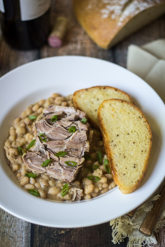 The holy grail of comfort food: slow cooker pork and beans from scratch! Comforting to eat, and comfortable to make; your slow cooker does ALL the work!