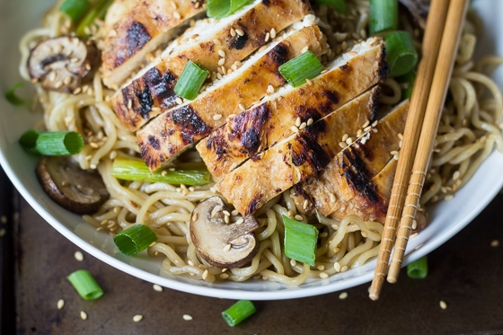 Craving at take-out noodle bowl? This Garlic Ginger Chicken with Sesame Noodles is quick, easy, and hits the spot every time!