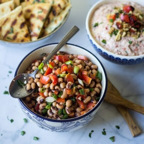 This Turkish Black Eyed Pea Salad recipe is so easy with a tasty mix of black eyed peas, red bell pepper, scallions, olive oil, lemon juice, sea salt and black pepper for a delicious side dish.