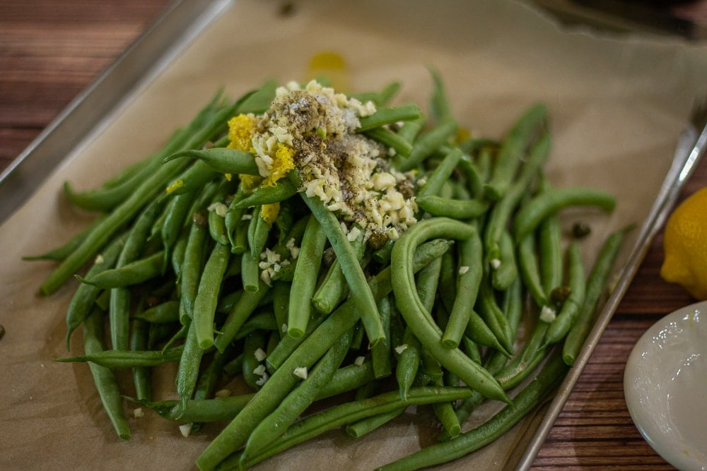 In this Best Ever Oven Roasted Green Beans recipe fresh green beans are oven-roasted with olive oil, lemon, garlic, and capers. Fancy enough for a holiday meal, easy enough for a weeknight side dish!