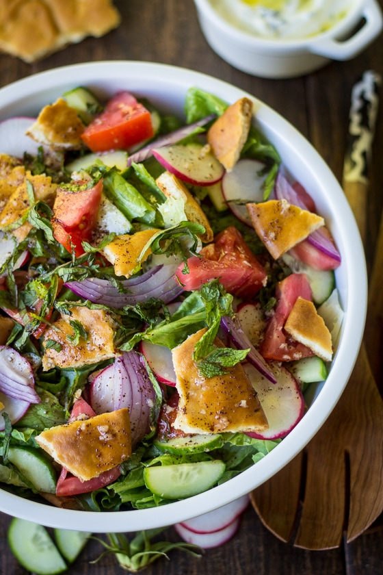Toasty pita bread, bright mint, and citrusy sumac bring plenty of flavor to this simple Lebanese Fattoush Salad recipe. Perfect with roast pork, chicken kebabs, or as an easy lunch option!