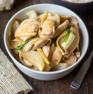 Thai Chicken with Ginger: Savory chicken, sharp onions, and bright ginger are coated in a wonderfully versatile stir-fry sauce in this take-out favorite.
