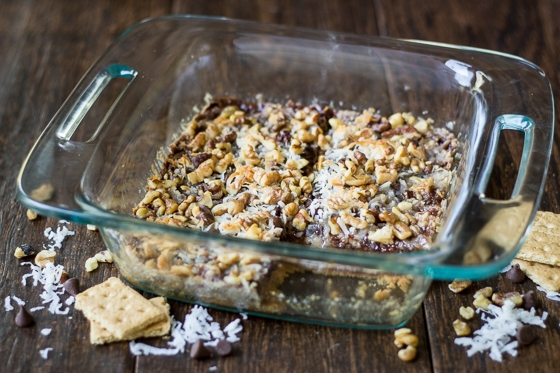 "Chocolate, coconut, walnuts, and crushed graham crackers make these cookie bars a family favorite. Make your own dairy-free sweetened condensed ""milk"" by simmering coconutmilk on the stovetop!"