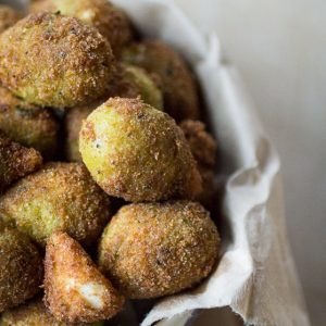 Deep Fried Olives: The perfect holiday appetizer! Just dip some drained olives in a beaten egg, coat with bread crumbs, and fry in olive oil. Make sure you have extra jars of olives on hand, because these will disappear quick!