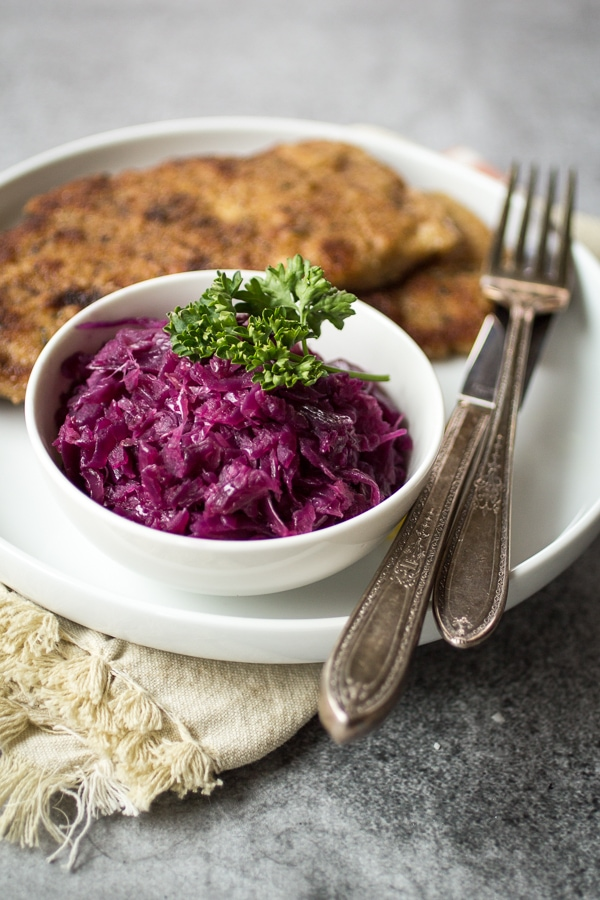 """Looking for German red cabbage recipes? Try this great one! Juniper berries, green apple, and tangy vinegar give this German style red cabbage it's distinctive sweet and sour flavor. Make a big batch of this """"rotkohl"""" and watch it disappear!"""