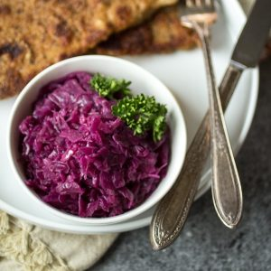 "Juniper berries, green apple, and tangy vinegar give this German braised red cabbage it's distinctive sweet and sour flavor. Make a big batch of this ""rotkohl"" and watch it disappear!"