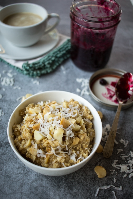 Raid your grocery store's bulk section to make this quick Creamy Coconut Oatmeal with Macadamia Nuts. Served with a spoonful of jam and a drizzle of cream, this breakfast will turn you into a morning person!