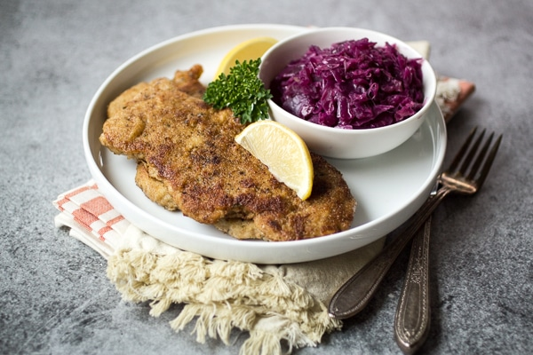How to make german pork schnitzel the wanderlust kitchen pan fried with a simple breading this german style recipe takes pork to forumfinder Image collections