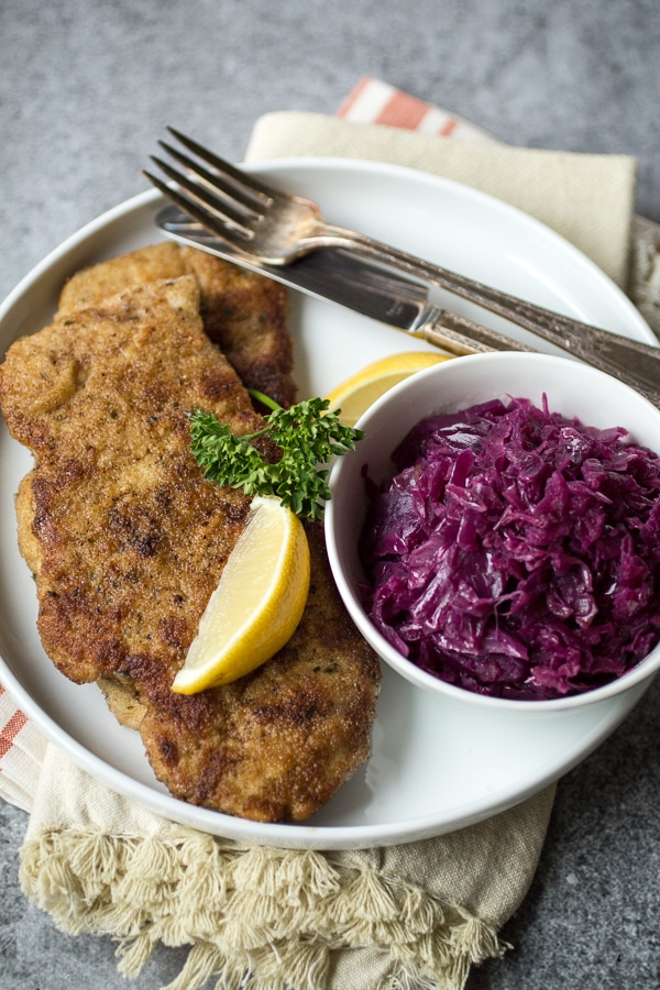 What is schnitzel? Find out with this recipe! Pan-fried with a simple breading, this German-style recipe takes pork to a whole new level. Pork Schnitzel is a 30-minute dinner recipe that will quickly become a family favorite!