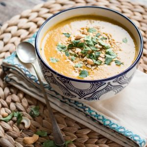 This Vegan Indian Sweet Potato Soup is richly spiced and made from simple, fresh ingredients. Perfect for busy nights and hungry families, this creamy soup is on the table in under 25 minutes