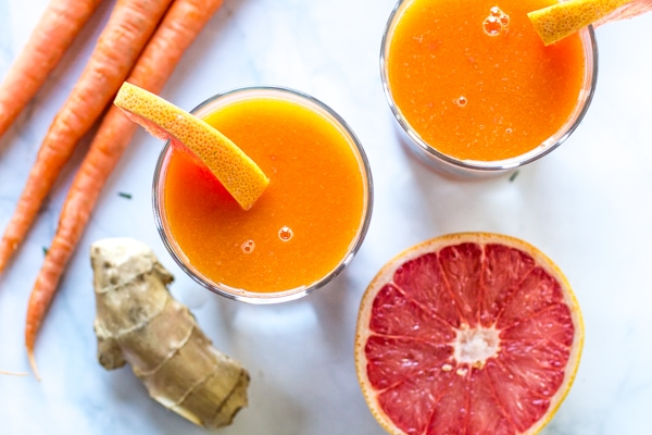 Looking for boost juice recipes? Here is a great one! This Immune Booster Juice recipe blends grapefruit, mango, and carrot for a delicious, healthy drink that is perfect for those days when you feel like you're coming down with something!