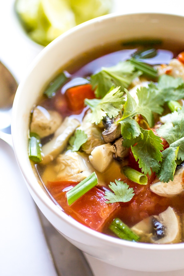 Looking for spicy soup recipes? Here is a delicious one! When you're feeling under the weather (or just in need of something delicious), this Spicy Thai Chicken Soup hits the spot every time!