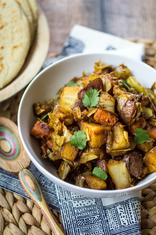 This easy Ethiopian Potatoes and Cabbage dish is one of my favorite parts of any Ethiopian meal! Humble Atakilt Wat is made from cabbage, carrots, and potatoes spiced with fragrant Berbere seasoning. Serve it with simmered lentils and Ethiopian flatbread for an easy weeknight dinner!