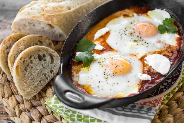 Whether enjoyed first thing in the morning, or as an easy breakfast-for-dinner, this classic dish of eggs simmered in spicy tomato sauce will both delight and satisfy. Be sure to serve your shakshuka recipe with harissa with plenty of crusty bread for dipping!