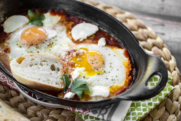 Whether enjoyed first thing in the morning, or as an easy breakfast-for-dinner, this classic dish of eggs simmered in spicy tomato sauce will both delight and satisfy. Be sure to serve your Shakshuka with Harissa (or, eggs in purgatory) with plenty of crusty bread for dipping!