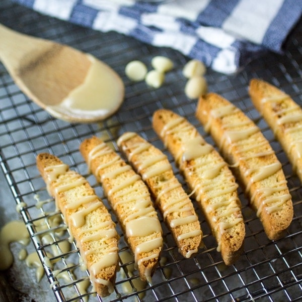 Biscotti is just the thing for busy mornings and lazy weekends. This easy recipe for Macadamia Nut Biscotti is taken to the next level with a drizzle of quick white mocha sauce. Your cup of coffee just got upgraded!