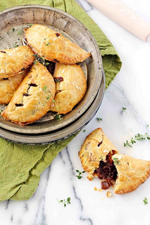 Stout Caramelized Onion Hand Pies | Just in time for St. Patrick's Day! 12 Vegetarian Guinness Recipes - on thewanderlustkitchen.com