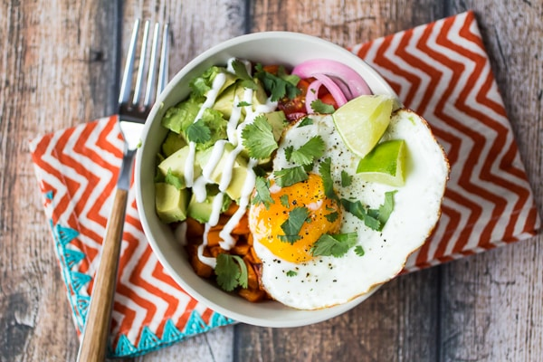 Stuck in a boring breakfast rut? Take 15 minutes and make this easy Sweet Potato Egg Breakfast Bowl recipe! This winning combination of tender sweet potato, creamy avocado, sweet tomatoes, and perfectly poached egg will keep you full and satisfied until lunch.