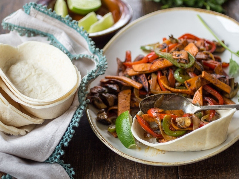Tender sweet potato and smoky mushrooms stand in for meat in this easy vegan sweet potato fajita recipe!